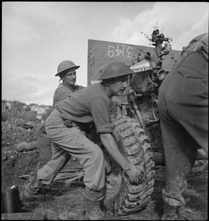 NZ Artillerymen moving gun in the Sangro River area of the Italian front, World War II - Photograph taken by George Kaye