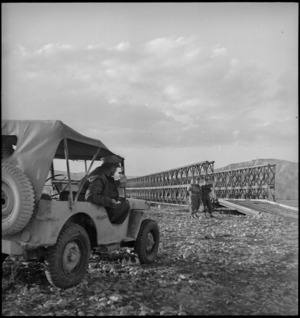 General Freyberg in jeep near Bailey bridge constructed by NZ Engineers across Sangro River, Italy, World War II - Photograph taken by George Kaye