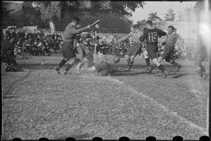 Play in the rugby football match between NZ Base and the Exiles at the Alamein Club in Cairo - Photograph taken by G Bull