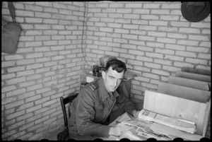Editor of the NZEF Times, Mr H L Heatley at his desk in Cairo, Egypt, World War II - Photograph taken by George Bull