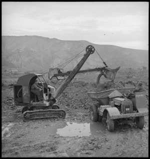 NZ Engineers using a mechanical shovel and dumptor in the forward areas of the Italian Front, World War II - Photograph taken by George Kaye