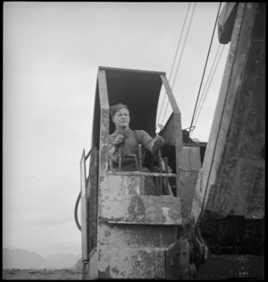 F T Gill operating a mechanical shovel in the forward areas of the Italian Front, World War II - Photograph taken by George Kaye