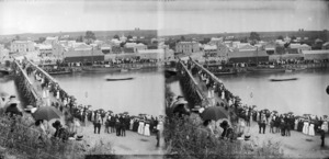 Crowd watching a boat race on the Waitara River