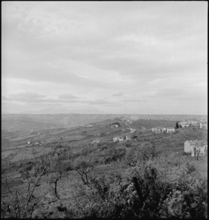 Smoke from enemy shells just beyond the town of Castelfrentano, Italy, during World War II - Photograph taken by George Kaye