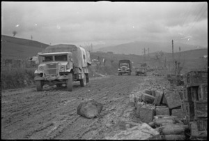 2 NZ Divison transport on the rain soaked and muddy roads of the Italian Front, World War II - Photograph taken by George Kaye
