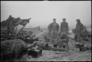 A hot brew being prepared under difficult conditions by some men of the 2 NZ Divisional Artillery, Italian Front, World War II - Photograph taken by George Kaye