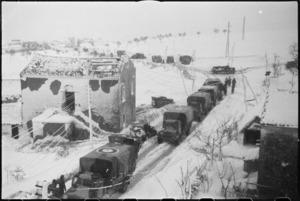 Heavy snowfall slows NZ Division transport on Castelfrentano-Guardiagrele turnoff, Italian Front, World War II - Photograph taken by George Kaye