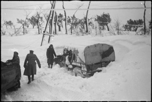 NZ Division vehicle dug out from snow drift in NZ Sector of the Italian Front, World War II - Photograph taken by George Kaye