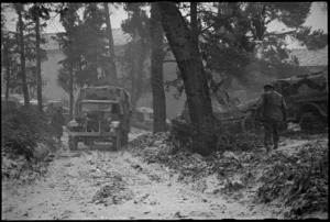 Truck of NZ Division makes its way through wooden country during a snowstorm on Italian Front, World War II - Photograph taken by George Kaye