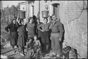 New Zealanders billetted in village behind Italian Front make friends with the household, World War II - Photograph taken by George Kaye