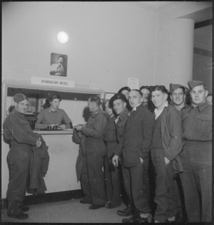 Group of New Zealanders at the information desk at the NZ Forces Club in Bari, Italy, World War II - Photograph taken by M D Elias