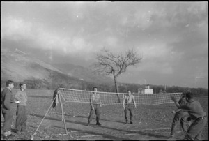 Members of 2 NZ Division playing tennequoits in the Volturno Valley, Italy, World War II - Photograph taken by George Kaye
