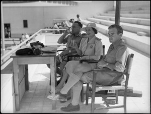 Lady Freyberg with Colonel McGavin and a Regimental Officer at 19 NZ Armoured Regiment swimming sports, Cairo - Photograph taken by G Kaye