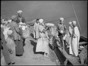 Bargeload of melons being unloaded and sold near the 'Mad Mile', Cairo - Photograph taken by George Kaye
