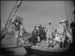 Buyers carrying goods off boat on Nile, Egypt - Photograph taken by George Kaye