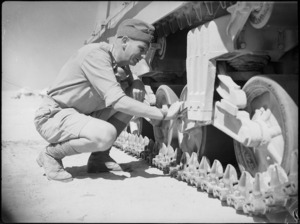 Inspection of tank suspension at 4th Armoured Brigade workshops in Maadi, Egypt - Photograph taken by George Kaye