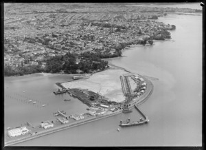 Westhaven, Auckland, showing the partial construction of the Auckland Harbour Bridge