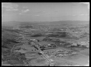 Moerewa Township, Northland, looking north east along George Street (State Highway 1) and Otiria Road, with residential housing foreground to the AFFCO dairy factory, with farmland and Kawakawa Township beyond