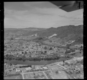 Ngaruawahia road and rail bridges under construction over the Waikato River, with the Great South Road through town, Waikato Region