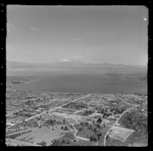 Taupo, includes view of lake, roads, housing, and Mt Ruapehu