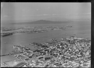Auckland city centre with the Ports of Auckland wharves and harbour entrance, with Devonport and Rangitoto Island beyond, Auckland City