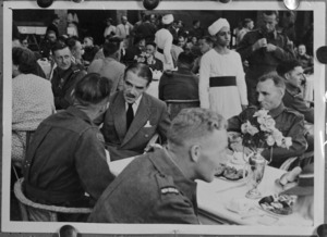 British Minister Richard Casey in conversation with returned Kiwis at a garden party for repatriated POWs, Gazira Sporting Club, Cairo