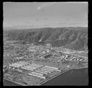 Lower Hutt suburb of Seaview with the Ford Motors Plant, fuel storage tanks and other industrial buildings, with Wainuiomata access road beyond, Wellington Region