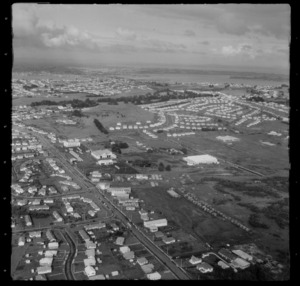 Stoddard Road with bus depot and lumberyard, with Winstone Park and Manukau Harbour beyond, Onehunga, Auckland