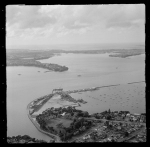 Point Erin Park and Westhaven Marina with the construction of the Auckland Harbour Bridge, Northcote Point beyond, Auckland City