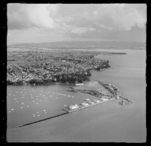Point Erin Park and Westhaven Marina with the construction of the Auckland Harbour Bridge, Point Chevalier beyond, Auckland City