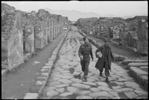 Two New Zealand soldiers walk down ancient streets of Pompei, Italy, World War II - Photograph taken by George Kaye