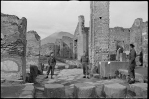 Three Kiwis stand at the intersection of the Stabian Way in Pompei, Italy, World War II - Photograph taken by George Kaye