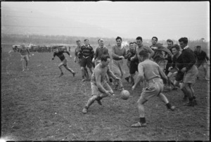 Members of NZ Public Relations Service play rugby football behind the lines on the Italian Front, World War II - Photograph taken by George Kaye