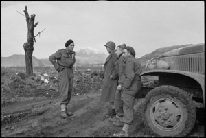 New Zealand and American troops fraternize with Monte Cairo in the background, Italy, World War II - Photograph taken with George Kaye
