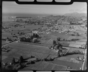 The Nelson suburb of Stoke on Waimea Inlet with Main Road and orchards in foreground and to Greenmeadows Park beyond, Nelson City