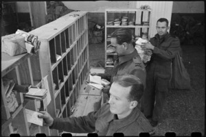 Sorting mail at NZ MPO in Bari, Italy, World War II - Photograph taken by George Bull