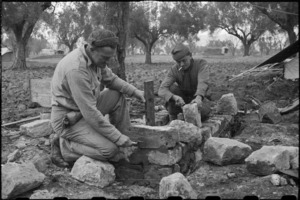 Gunner C S Land (Auckland) and Corporal G M Winlove laying foundation for their field oven, Italy, World War II - Photograph taken by George Bull