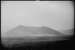 General view of Mount Trocchio seen through dust from enemy shelling, Italy, World War II - Photograph taken by George Kaye