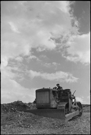 Bulldozer at work in the forward areas of the Monte Cassino Front, Italy, World War II - Photograph taken by George Kaye