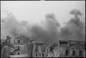 Smoke from the raid on Cassino rising behind the ruins of Cevaro, Italy, World War II - Photograph taken by George Kaye