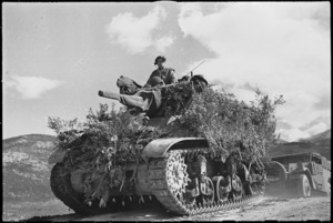 Camouflaged tank moving forward in readiness for armoured assault on Cassino, Italy, World War II - Photograph taken by George Kaye