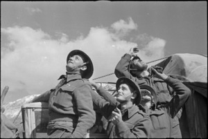 NZ anti aircraft gunners watch bombers flying over to participate in air assault on Cassino, Italy, World War II - Photograph taken by George Kaye