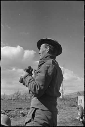 J R Allen on the lookout for enemy planes during the bombing of Cassino, Italy, World War II - Photograph taken by George Kaye