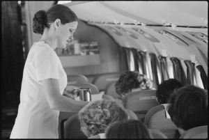 Air hostess serving drinks