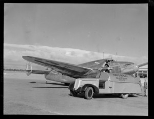 Lockheed Lodestar aeroplane 'Karoro' ZK-AHU, being refuelled by unidentified aircraft technicians, an an aerodrome, location unidentified