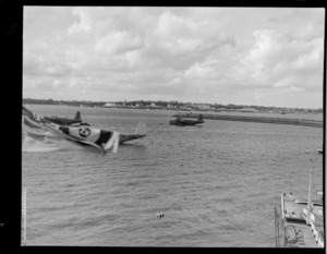 Flying boats, including a Short S25 Sunderland and a Short S23 Empire, at anchor on Mechanics Bay, Auckland