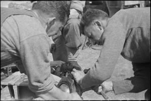 New Zealanders work on a motor near the Cassino Front in Italy, World War II - Photograph taken by George Kaye
