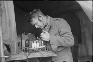 A J Murphy testing wireless set on the Cassino Front in Italy, World War II - Photograph taken by George Kaye