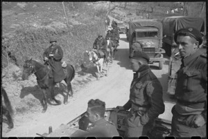 Mounted French Moroccan troopers part of crowded transport on the Cassino Front in Italy, World War II - Photograph taken by George Kaye