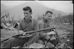 NZ front line infantry soldiers O S Sinclair and C R Monaghan recently engaged in heavy fighting around Cassino, Italy, World War II - Photograph taken by George Kaye